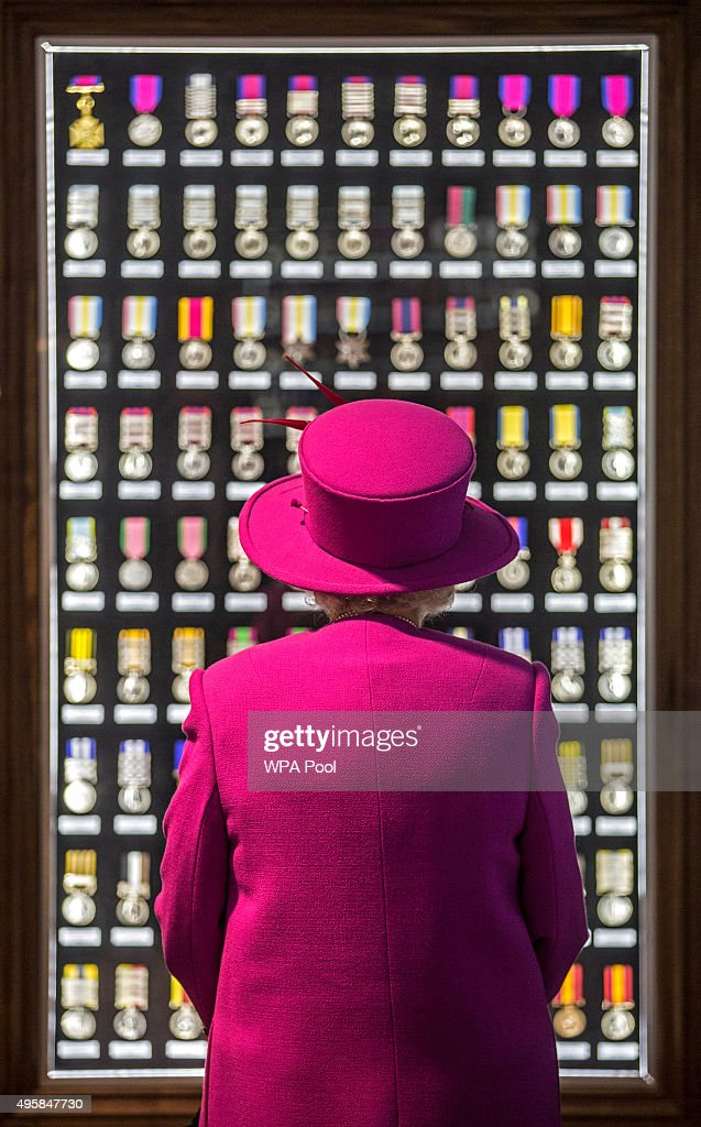 Queen Elizabeth II looks upon a cabinet of medals during a visit to the medal room in the Ministry of defence medal office at the joint casualty and compassionate centre within Imjin barracks on November 5, 2015 in Innsworth, Gloucestershire, United Kingdom.