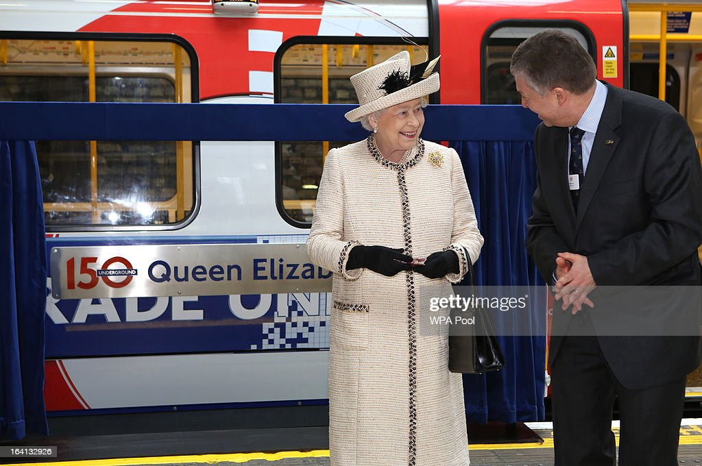 Queen Elizabeth II makes an official visit to Baker Street Underground Station, to mark 150th anniversary of the London Underground on March 20, 2013 in London, England.