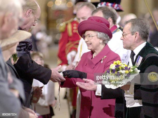 Queen Elizabeth II marks Maundy Thursday by distributing Maundy Money to pensioners during a service at Lincoln Cathedral The 148 recipients have...