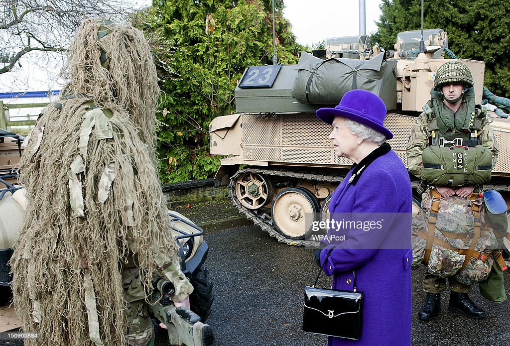 Queen <a gi-track='captionPersonalityLinkClicked' href=/galleries/search?phrase=Elizabeth+II&family=editorial&specificpeople=67226 ng-click='$event.stopPropagation()'>Elizabeth II</a> meets a camouflaged sniper from the Household Cavalry at Combermere Barracks on November 26, 2012 in Windsor, England.