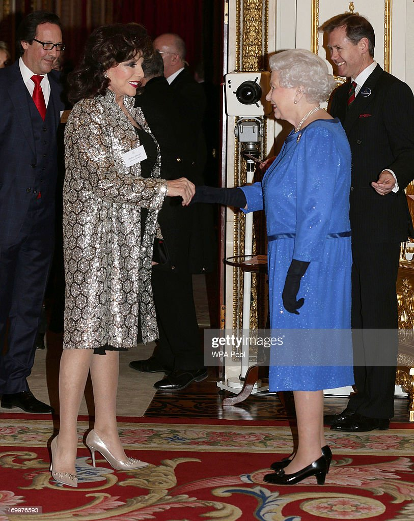 Queen Elizabeth II meets actress Joan Collins during the Dramatic Arts reception at Buckingham Palace on February 17, 2014 in London, England.