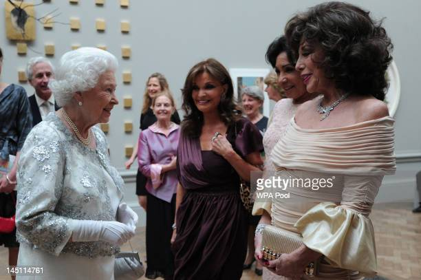 Queen Elizabeth II meets actress Joan Collins singer Shirley Bassey and actress Kate O'Mara at a special 'Celebration of the Arts' event at the Royal...
