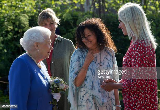 Queen Elizabeth II meets Anneka Rice at the BBC Radio 2 Garden at the RHS Chelsea Flower Show press day at Royal Hospital Chelsea on May 22 2017 in...