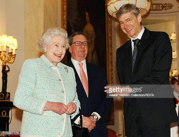 Queen Elizabeth II meets Arsenal chairman Peter HillWood and manager Arsene Wenger at Buckingham Palace on February 15 2007