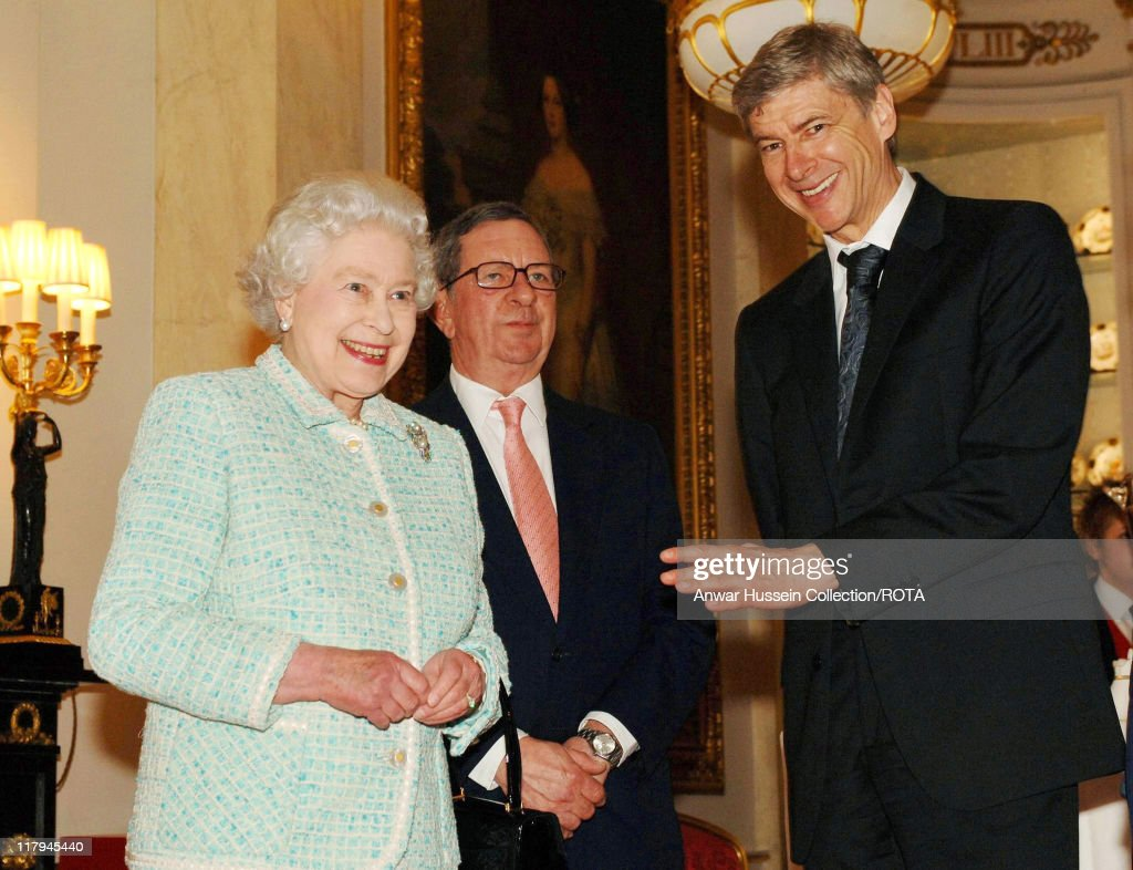 Queen Elizabeth II meets Arsenal chairman Peter Hill-Wood and manager <a gi-track='captionPersonalityLinkClicked' href=/galleries/search?phrase=Arsene+Wenger&family=editorial&specificpeople=171184 ng-click='$event.stopPropagation()'>Arsene Wenger</a> (right) at Buckingham Palace on February 15, 2007.