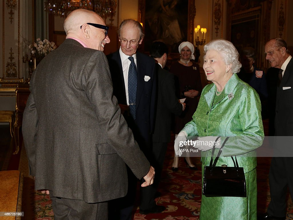 Queen Elizabeth II meets artist Brian Clarke, who designed the commemorative Winston Churchill Medallion, during the Winston Churchill Memorial Trust Reception at Buckingham Palace on March 18, 2015 in London, England.