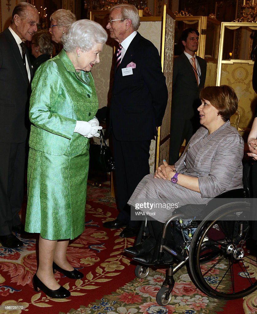 Queen Elizabeth II meets Baroness Tanni Grey-Thompson during the Winston Churchill Memorial Trust Reception at Buckingham Palace on March 18, 2015 in London, England.