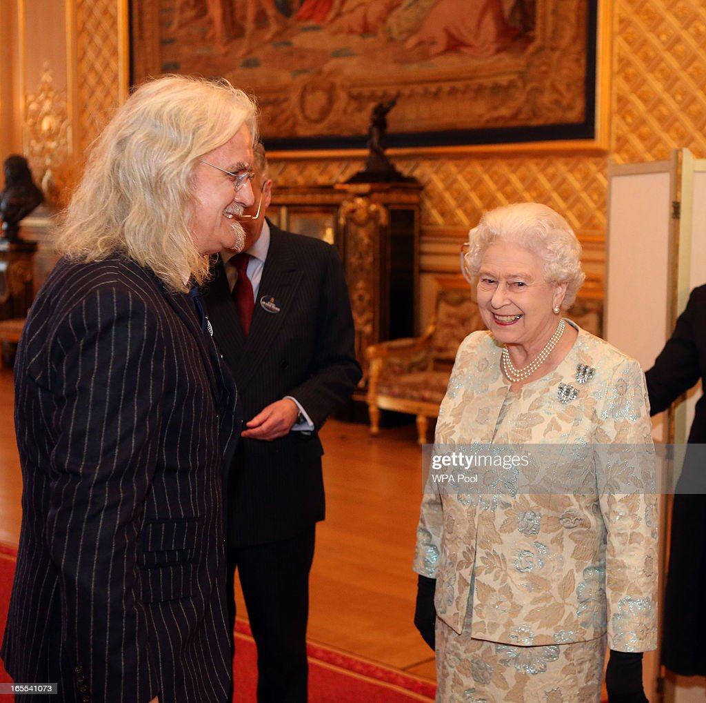 Queen <a gi-track='captionPersonalityLinkClicked' href=/galleries/search?phrase=Elizabeth+II&family=editorial&specificpeople=67226 ng-click='$event.stopPropagation()'>Elizabeth II</a> meets <a gi-track='captionPersonalityLinkClicked' href=/galleries/search?phrase=Billy+Connolly&family=editorial&specificpeople=208248 ng-click='$event.stopPropagation()'>Billy Connolly</a> at a reception for the British Film Industry at Windsor Castle on April 4, 2013 in Berkshire, England.