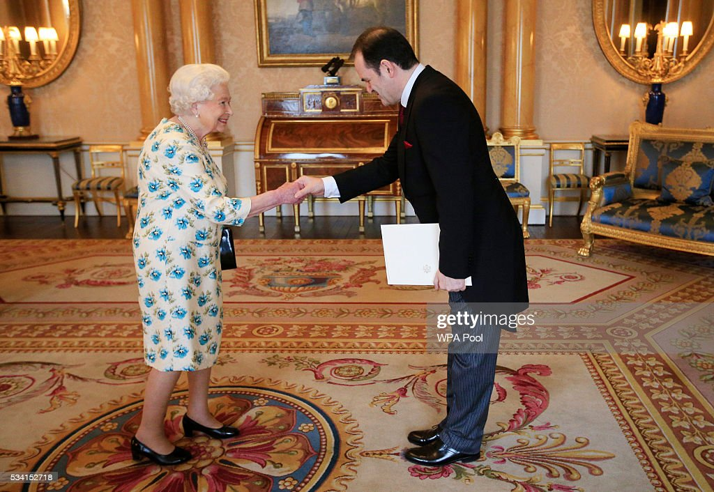 Queen Elizabeth II meets Borislav Banovic, the Ambassador from Montenegro, as he arrives to present his Letters of Credence during a private audience at Buckingham Palace on May 25, 2016 in London, England.