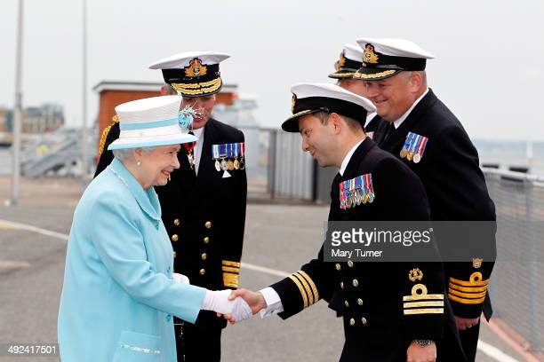 Queen Elizabeth II meets Commander Peter Laughton the Commanding Office of HMS Lancaster as she arrives at Portsmouth Naval Base for a visit to the...
