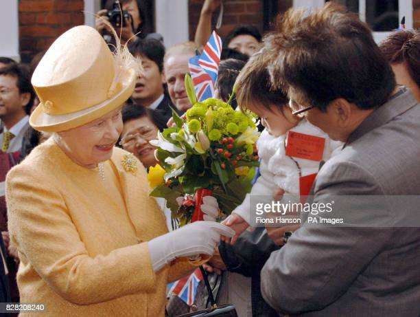 Queen Elizabeth II meets crowds including 16 onth old Ong Wai Jun while officially opening of the Camden Chinese Community Centre London on November...