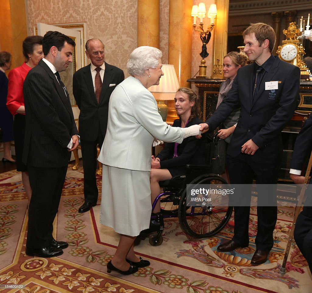 Queen Elizabeth II meets cyclist Jason Kenny during a reception for the Team GB Olympic and Paralympic medalists at Buckingham Palace on October 23, 2012 in London, England.