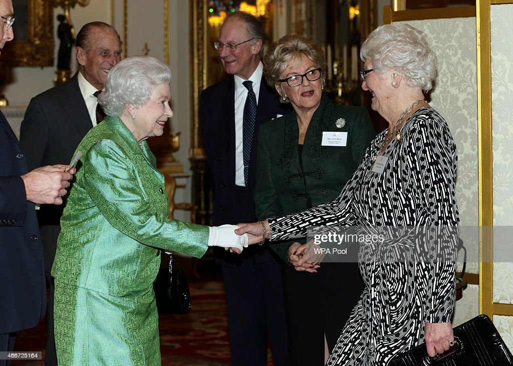 Queen Elizabeth II meets Dame Mary Peters (right) during the Winston Churchill Memorial Trust Reception at Buckingham Palace on March 18, 2015 in London, England.