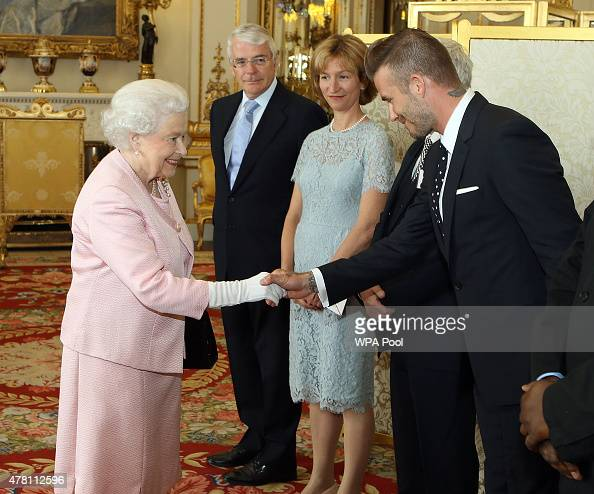 Queen Elizabeth II meets David Beckham at a reception at Buckingham Palace to celebrate The Queen's Young Leaders programme and present awards to the...