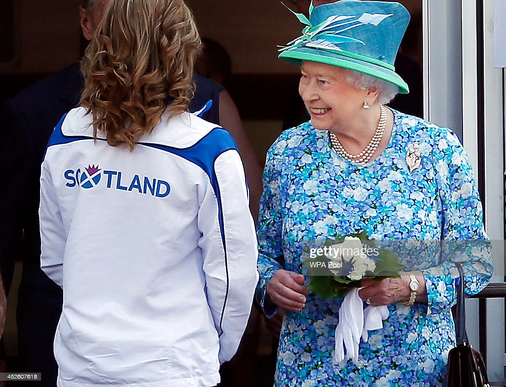 Queen Elizabeth II meets delegates and athletes on a visit to the Athlete's village during day one of the 20th Commonwealth Games on July 24, 2014 in Glasgow, Scotland.