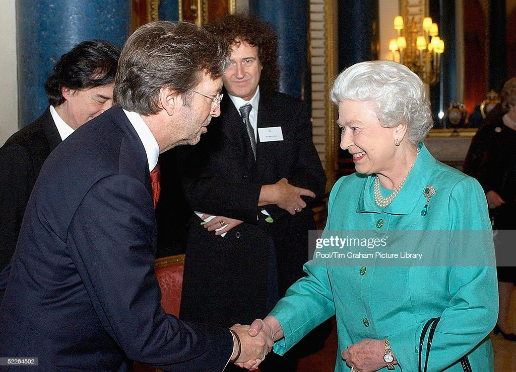 Queen <a gi-track='captionPersonalityLinkClicked' href=/galleries/search?phrase=Elizabeth+II&family=editorial&specificpeople=67226 ng-click='$event.stopPropagation()'>Elizabeth II</a> meets Eric Clapton at the 'Music Day At The Palace' event at Buckingham Palace on March 1, 2005 in London, England. The Royal reception was held to recognise the excellence of British music and the contribution it makes to the culture and economy of the UK.