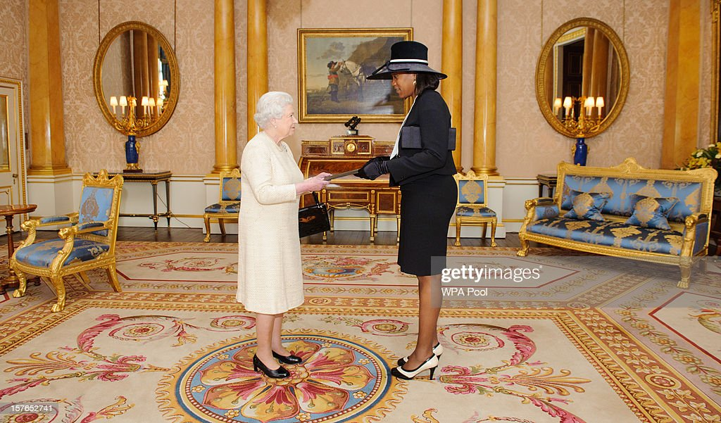 Queen Elizabeth II meets Francine Baron, the High Commissioner for the Commonwealth of Dominica at Buckingham Palace on December 5, 2012 in London, England.