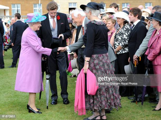 Queen Elizabeth II meets guests as she hosts a garden party in the grounds of Buckingham Palace on July 8 2008 in London England