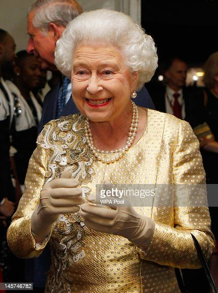 Queen Elizabeth II meets guests backstage after the Diamond Jubilee Buckingham Palace Concert on June 04 2012 in London England For only the second...