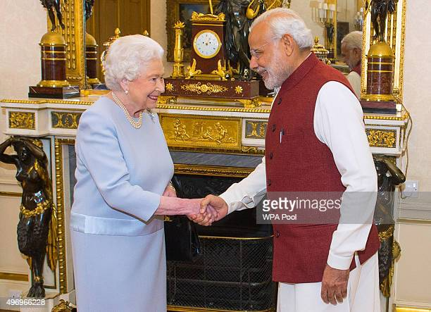 Queen Elizabeth II meets Indian Prime Minister Narendra Modi at Buckingham Palace on the second day of his visit to the UK on November 13 in London...