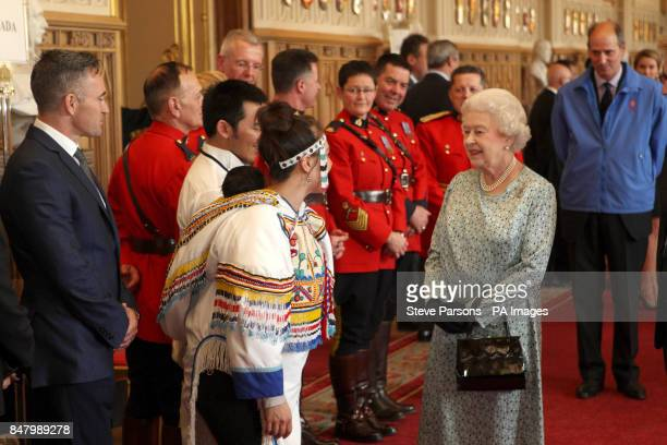 Queen Elizabeth II meets Inuit throat singer Celina Kalluk with her six week old daughter Ramata during a tea party for the cast of the Diamond...