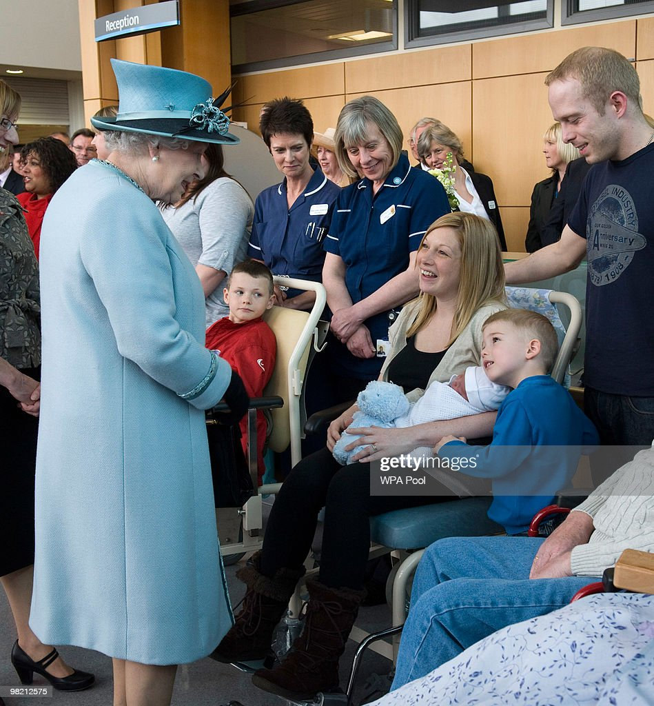 Queen Elizabeth II meets Keeley Ward who gave birth yesterday to baby boy Callen, and his brother Reian 4, as as she visits the Royal Derby Hospital to offically open it on April 1, 2010 in Derby, England.