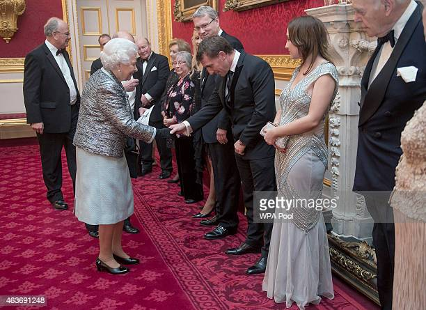 Queen Elizabeth II meets Liverpool manager Brendan Rodgers at a reception to mark the 80th anniversary of Diabetes UK at St James's Palace on...
