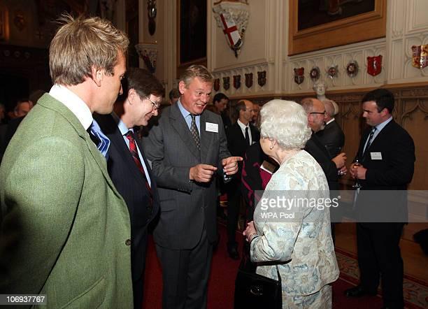 Queen Elizabeth II meets Martin Clunes as Ben Fogle looks on at the Rural Communities Reception at Windsor Castle on November 17 2010 in Berkshire...