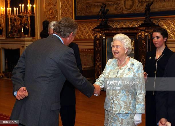 Queen Elizabeth II meets Martin Clunes at the Rural Communities Reception at Windsor Castle on November 17 2010 in Berkshire England