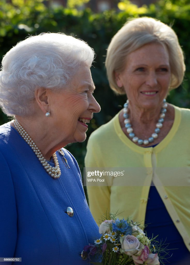 Queen Elizabeth II meets Mary Berry at the BBC Radio 2 Garden at the RHS Chelsea Flower Show press day at Royal Hospital Chelsea on May 22, 2017 in London, England. The prestigious Chelsea Flower Show, held annually since 1913 in the Royal Hospital Chelsea grounds, is open to the public from the 23rd to the 27th of May, 2017.