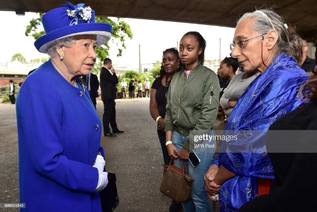 Queen Elizabeth II meets members of the community affected by the fire at Grenfell Tower in west London during a visit to the Westway Sports Centre which is providing temporary shelter for those who have been made homeless in the disaster on June 16, 2017 in London, England. 17 people have been confirmed dead and dozens still missing, after the 24 storey residential Grenfell Tower block in Latimer Road was engulfed in flames in the early hours of June 14. Emergency services will spend a third day searching through the building for bodies. Police have said that some victims may never be identified.
