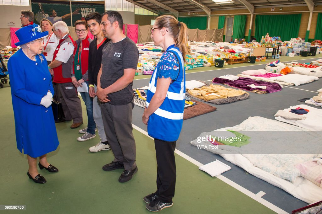 Queen Elizabeth II meets members of the community affected by the fire at Grenfell Tower in west London during a visit to the Westway Sports Centre, which is providing temporary shelter for those who have been made homeless in the disaster on June 16, 2017 in London, England. 30 people have been confirmed dead and dozens still missing, after the 24 storey residential Grenfell Tower block in Latimer Road was engulfed in flames in the early hours of June 14. Emergency services will spend a third day searching through the building for bodies. Police have said that some victims may never be identified.