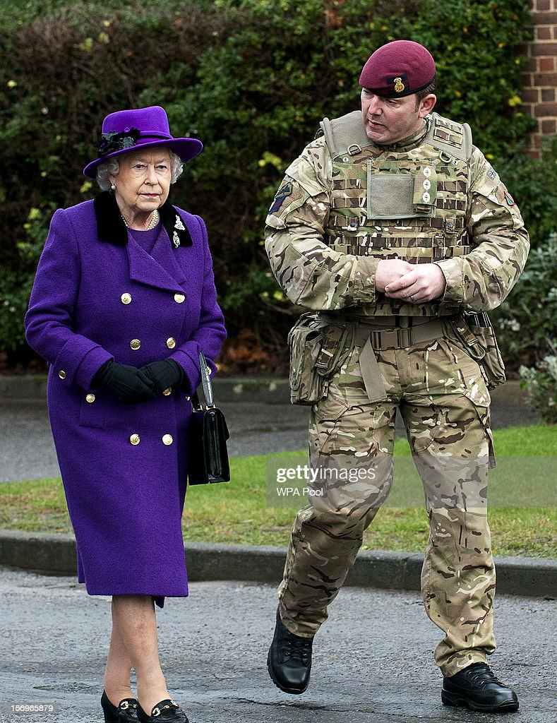 Queen <a gi-track='captionPersonalityLinkClicked' href=/galleries/search?phrase=Elizabeth+II&family=editorial&specificpeople=67226 ng-click='$event.stopPropagation()'>Elizabeth II</a> meets members of the Household Cavalry at Combermere Barracks on November 26, 2012 in Windsor, England.