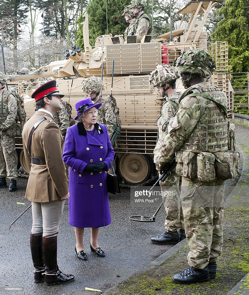 Queen Elizabeth II meets members of the Household Cavalry at Combermere Barracks on November 26, 2012 in Windsor, England.