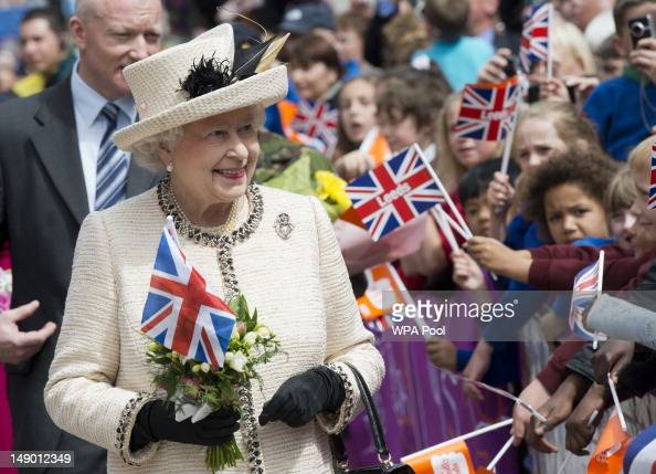 Queen Elizabeth II meets members of the public during a visit to the City Varieties Music Hall where she watched a 'Good Old Days' theatrical...