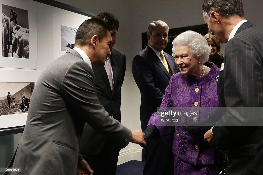 Queen <a gi-track='captionPersonalityLinkClicked' href=/galleries/search?phrase=Elizabeth+II&family=editorial&specificpeople=67226 ng-click='$event.stopPropagation()'>Elizabeth II</a> meets Nepalese Sherpa mountain climber Jamling Norgay (left), the son of Tenzing Norgay, a reception to celebrate the 60th Anniversary of the ascent of Everest, at the Royal Geographical Society in Kensington, on May 29, 2013 in west London, England.
