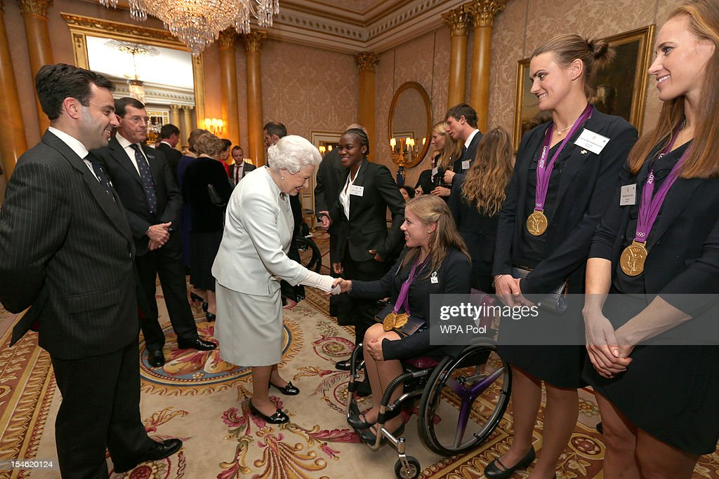 Queen <a gi-track='captionPersonalityLinkClicked' href=/galleries/search?phrase=Elizabeth+II&family=editorial&specificpeople=67226 ng-click='$event.stopPropagation()'>Elizabeth II</a> meets paralympian Hannah Cockcroft during a reception for the Team GB Olympic and Paralympic medalists at Buckingham Palace on October 23, 2012 in London, England.