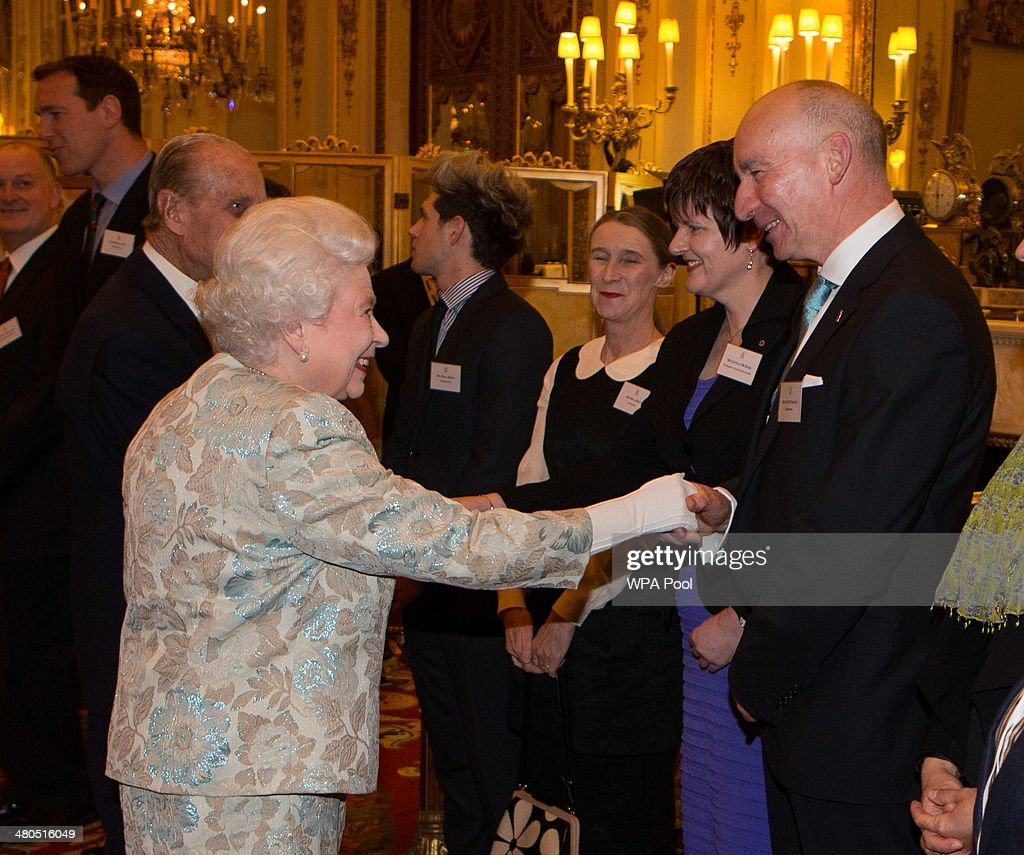 Queen <a gi-track='captionPersonalityLinkClicked' href=/galleries/search?phrase=Elizabeth+II&family=editorial&specificpeople=67226 ng-click='$event.stopPropagation()'>Elizabeth II</a> meets Pat O'Connell (R) at the Irish Community Reception at Buckingham Palace on March, 25, 2014. The reception is in a advance of Ireland's President Michael D Higgins who will be the first Irish President to pay a state visit to Britain in April.