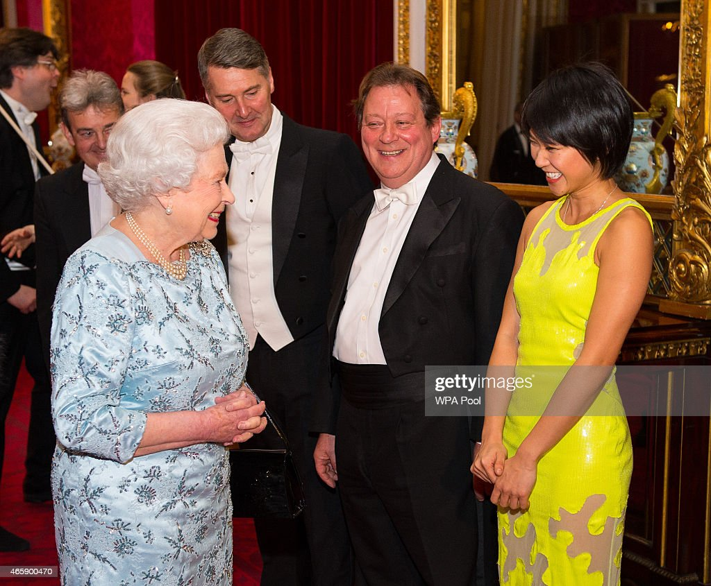 Queen Elizabeth II meets pianist Yuja Wang (right), during a reception to mark the conclusion of the 'Moving Music' campaign and the long association of conductor Michael Tilson Thomas with the London Symphony Orchestra, at Buckingham Palace on March 11, 2015 in London, United Kingdom.