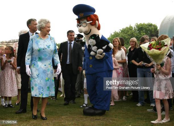 Queen Elizabeth II meets Postman Pat and his cat among storybook characters at the Children's Party at the Palace a children's literacy garden party...