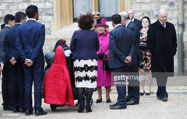 Queen Elizabeth II meets recipients of Motability vehicles as she arrives in the Quadrangle at Windsor Castle to host a ceremony to celebrate the...