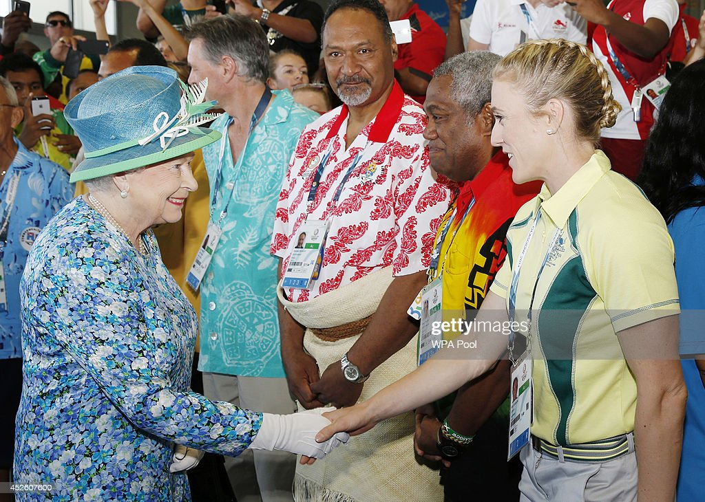 Queen Elizabeth II meets Sally Pearson of Australia on a visit to the Athlete's village during day one of the 20th Commonwealth Games on July 24, 2014 in Glasgow, Scotland.