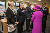 Queen Elizabeth II meets Sapper Jim Wilson of the Royal Engineers a double amputee from an IED blast in Afghanistan at the Ministry of defence medal...