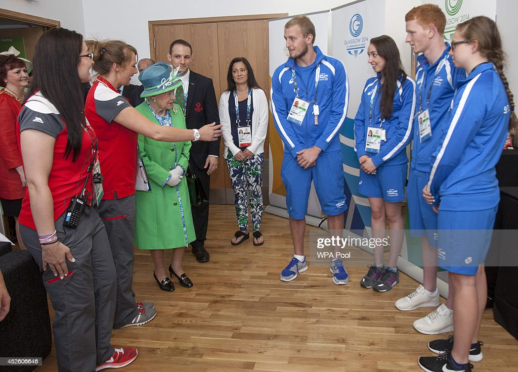 Queen Elizabeth II meets Scottish Swimmers during a visit the Tollcross International Swimming Centre during day one of the 20th Commonwealth Games on July 24, 2014 in Glasgow, Scotland.
