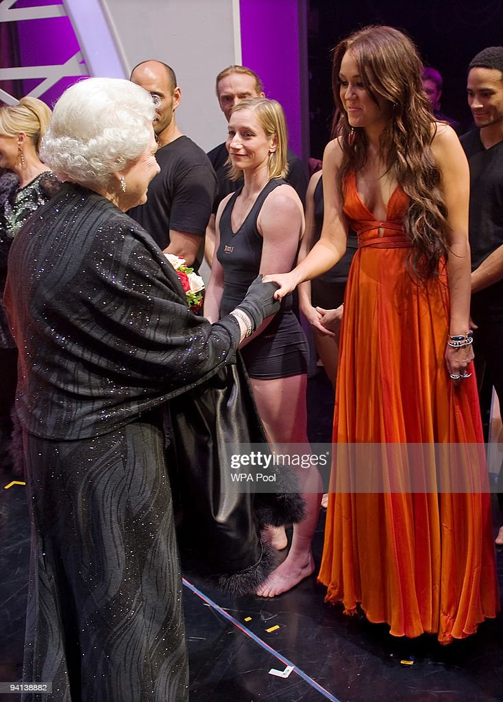 Queen <a gi-track='captionPersonalityLinkClicked' href=/galleries/search?phrase=Elizabeth+II&family=editorial&specificpeople=67226 ng-click='$event.stopPropagation()'>Elizabeth II</a> meets singer Miley Cyrus following the Royal Variety Performance on December 7, 2009 in Blackpool, England
