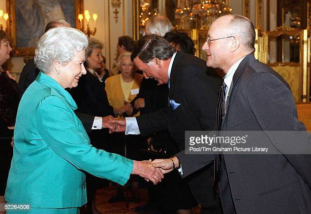Queen Elizabeth II meets singer Phil Collins at the 'Music Day At The Palace' event at Buckingham Palace on March 1 2005 in London England The Royal...