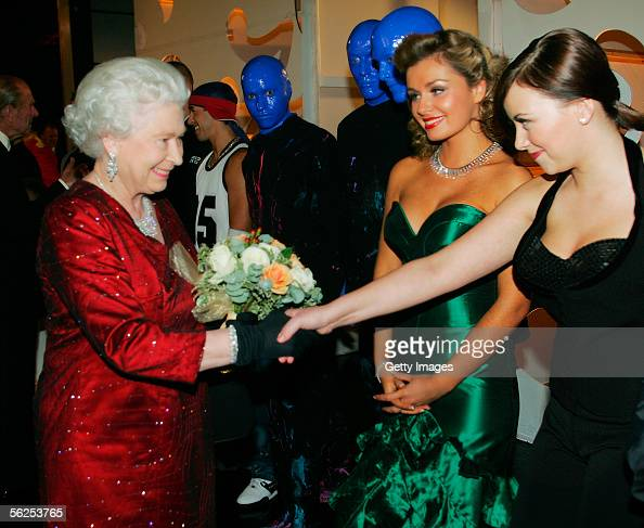 HM Queen Elizabeth II meets singers Charlotte Church and Katherine Jenkins as The Blue Man Group look on backstage following the Royal Variety...