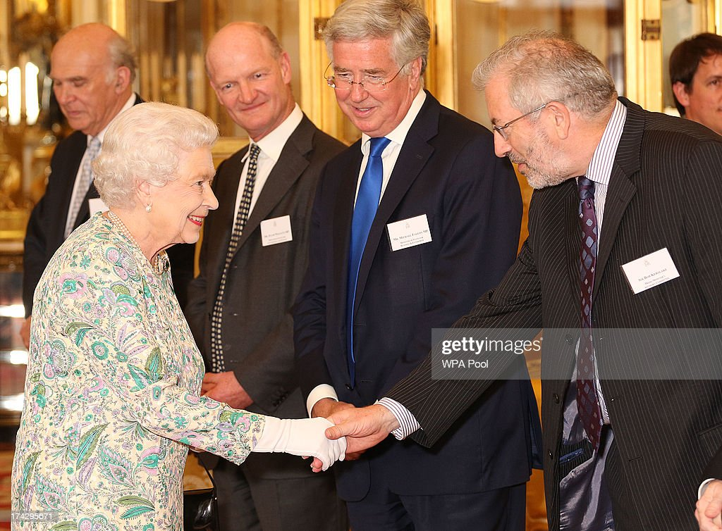 Queen <a gi-track='captionPersonalityLinkClicked' href=/galleries/search?phrase=Elizabeth+II&family=editorial&specificpeople=67226 ng-click='$event.stopPropagation()'>Elizabeth II</a> meets Sir Bob Kerslake, from the prime Ministers Advisory Committee, at a reception for the Winners of the Queens Award for Enterprise 2013 at Buckingham Palace in London. Tuesday July 23, 2013.