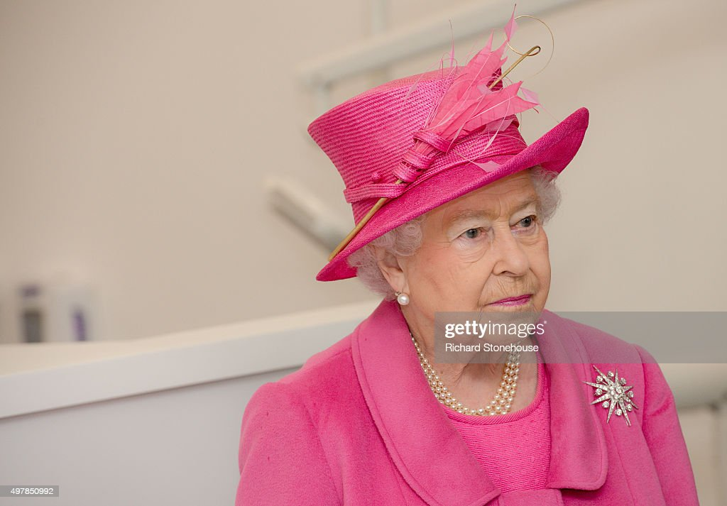 Queen Elizabeth II meets staff during a tour of the new Birmingham Hospital and School of Dentistry before officially opening the building, on November 19, 2015 in London, England.