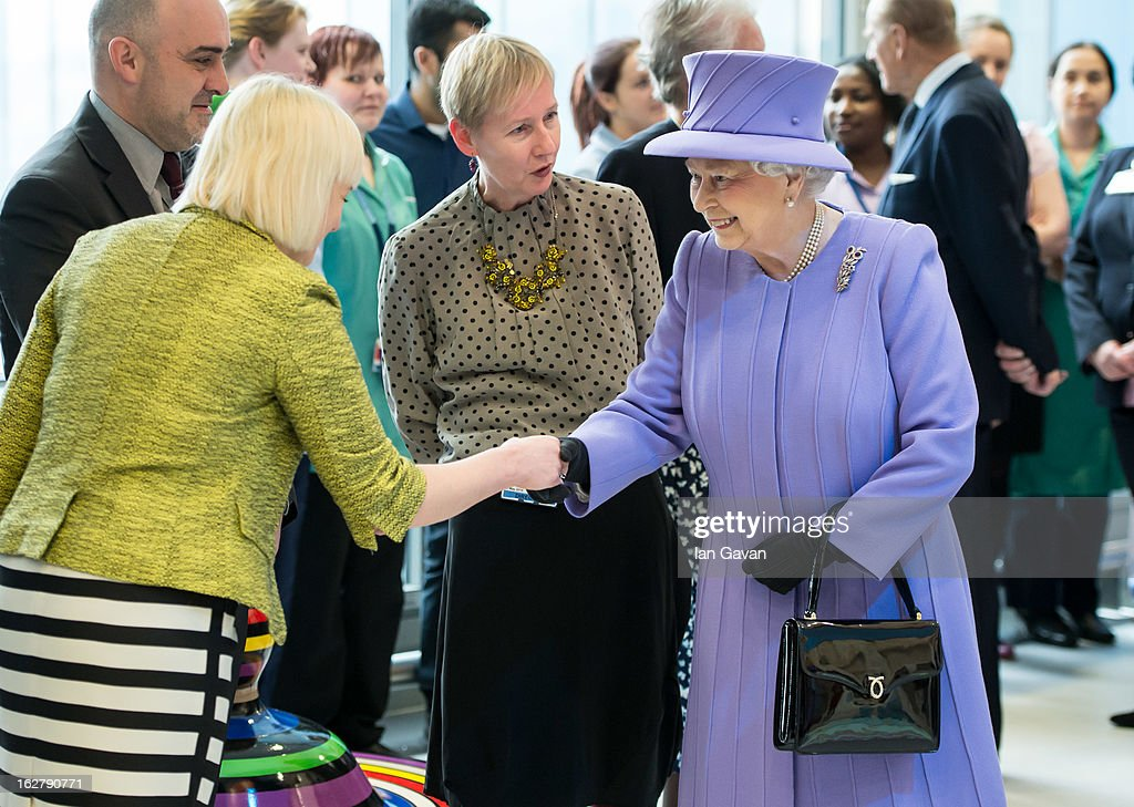 Queen <a gi-track='captionPersonalityLinkClicked' href=/galleries/search?phrase=Elizabeth+II&family=editorial&specificpeople=67226 ng-click='$event.stopPropagation()'>Elizabeth II</a> meets staff during her tour to open the new Royal London Hospital building and the new National Centre for Bowel Research and Surgical Innovation on February 27, 2013 in London, England.